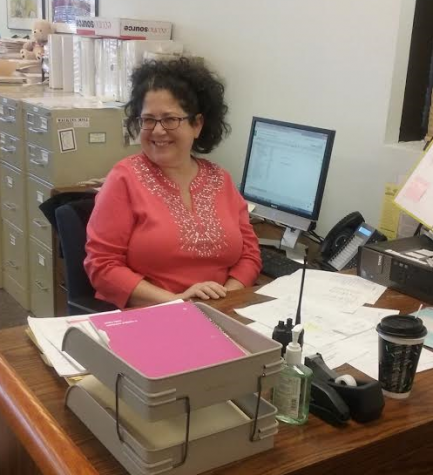 New main office secretary greets visitors with smiles, quirky sense of humor