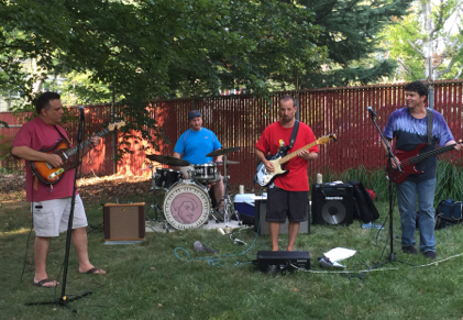 Biology teacher takes 'Soul Trip,' plays drums in local band
