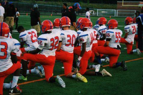 Football, girls soccer teams protest injustice by kneeling during National Anthem