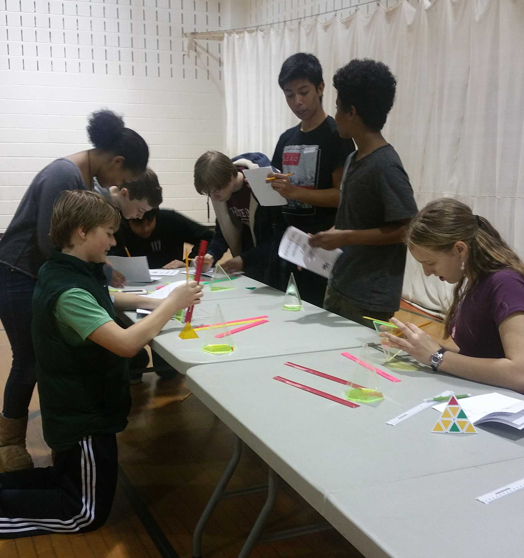 Geometry students solve problems as their RQA during the Geometry Fair