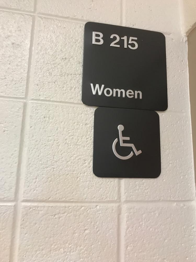 Girls bathroom sign at Watkins Mill High School.