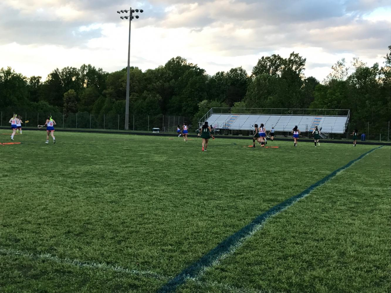 Girl's lacrosse in the middle of a game.