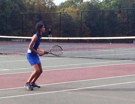 Freshman Bianca Johnson waits on a serve