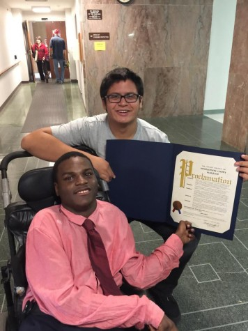 Junior Brandon Rodriguez poses with senior Ibra Samia after receiving the County Council Proclamation