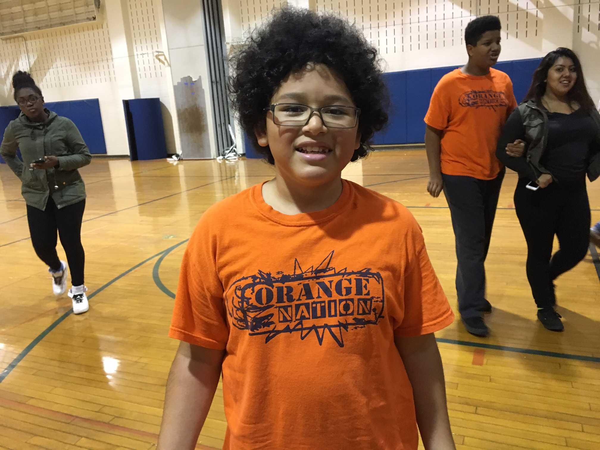 Freshman Victor Quintanilla wears his Orange Nation shirt in PE class