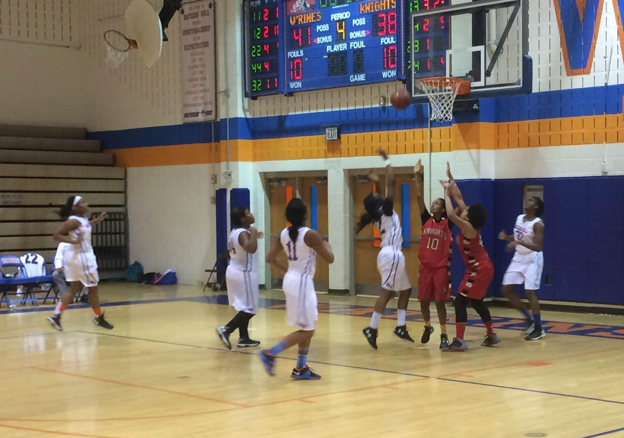 Sophomore Princess Frazier shoots a buzzer beater to win against the Wheaton Knights on Monday.