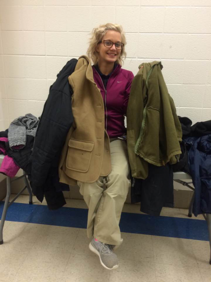 Security+guard+Kelsea+Kephart+shows+off+some+of+the+coats+that+are+available+for+students+who+need+them.