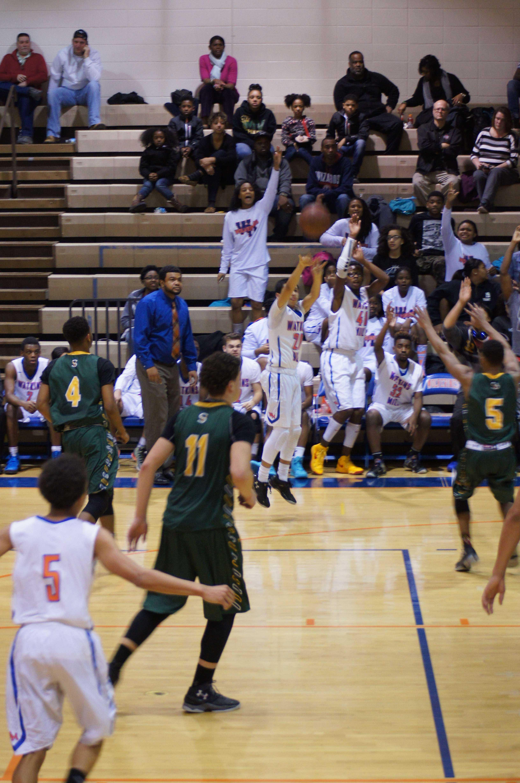 sophomore Jamie Castillo shooting the wide open three