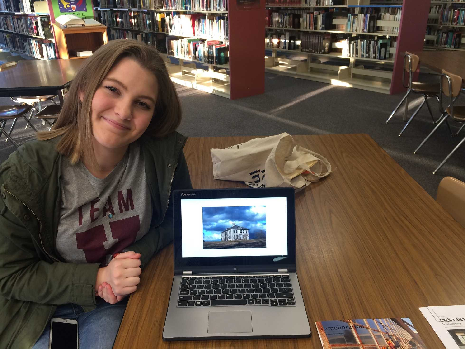 Sophomore Catherine Hodge sits with her project.