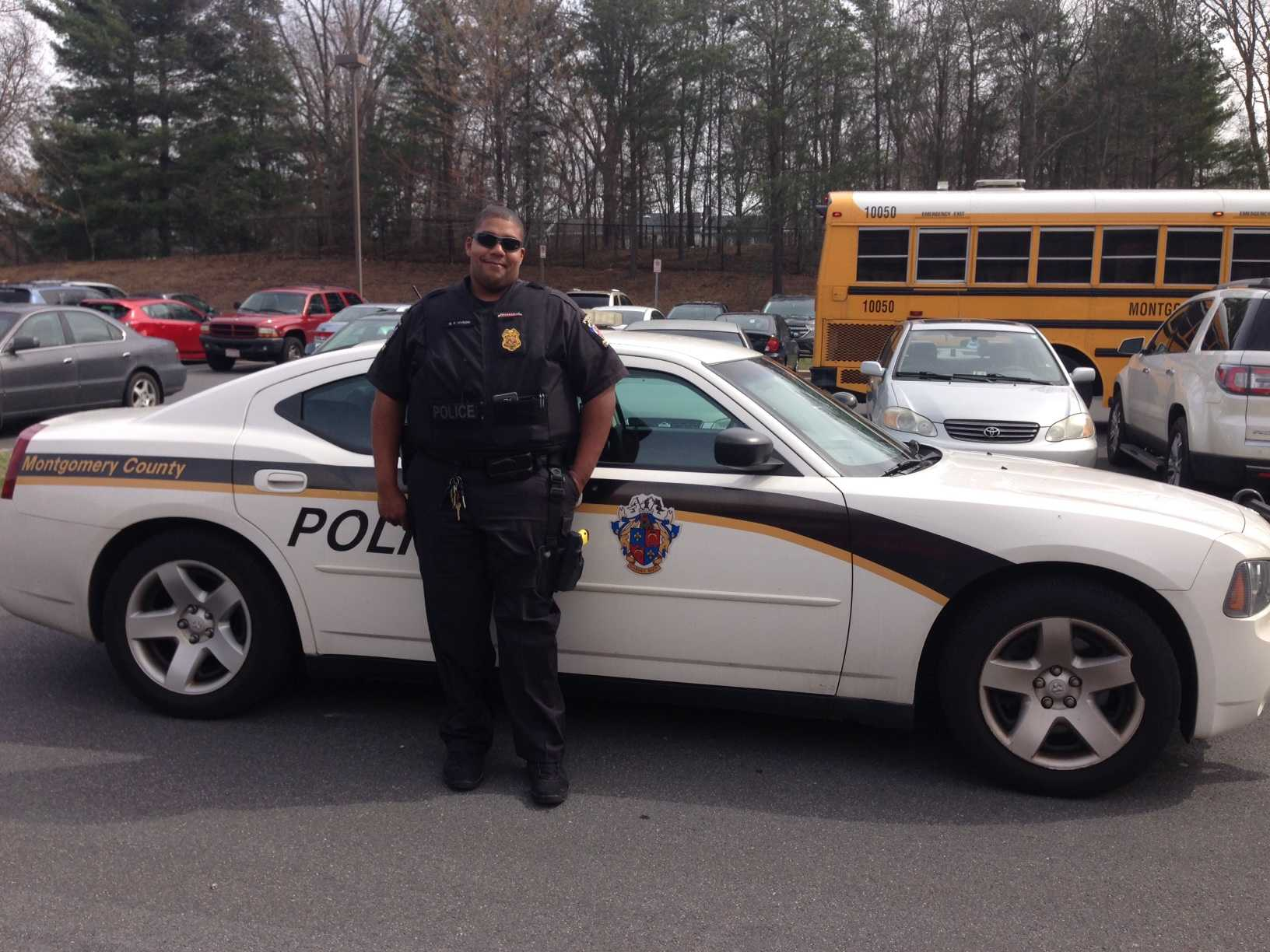 School Resource Officer George Hyson in front of his squad car at Watkins Mill High School