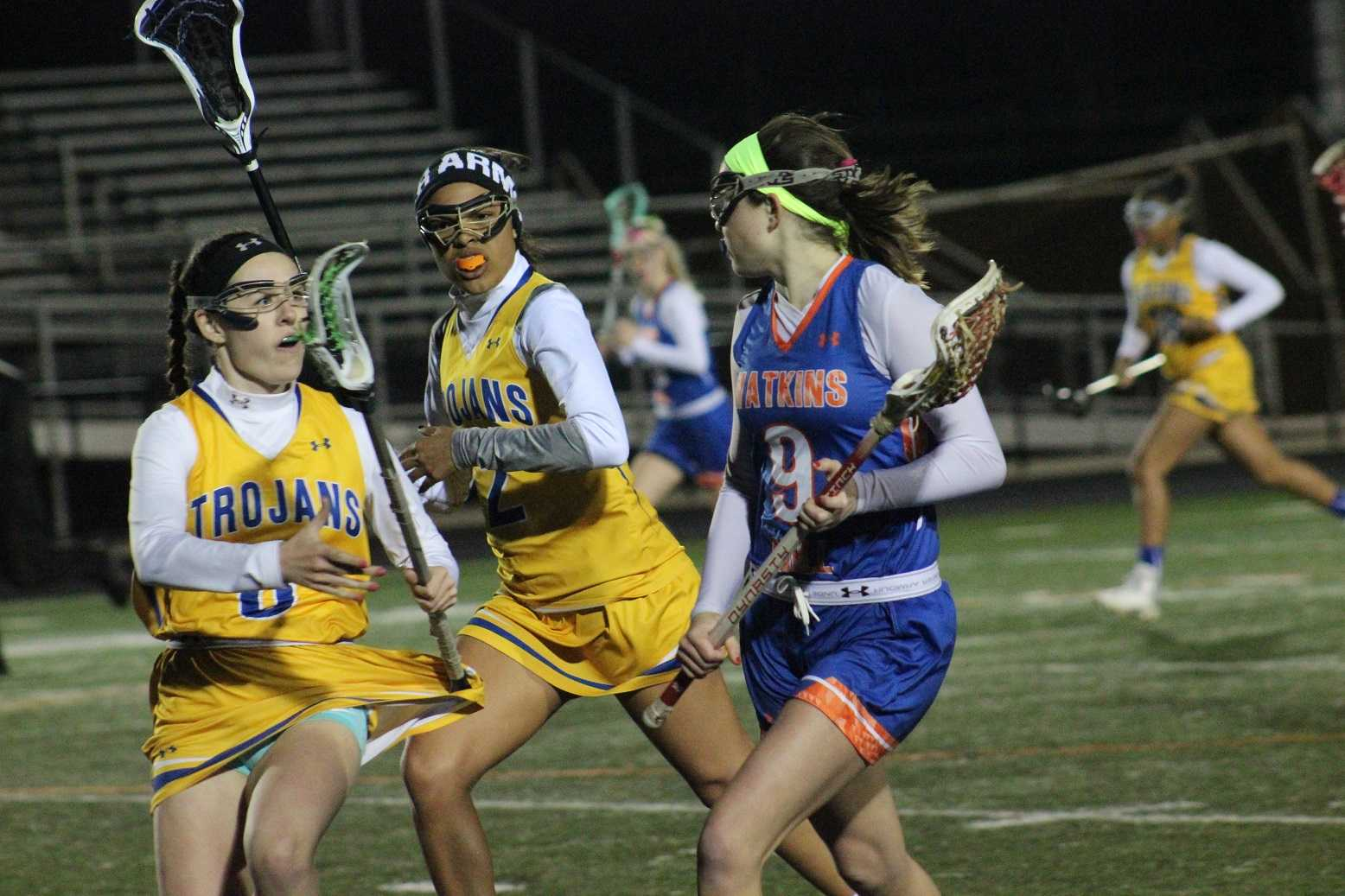 Sophomore Katherine Campbell runs the ball down the field while defending it against Gaithersburg Trojans