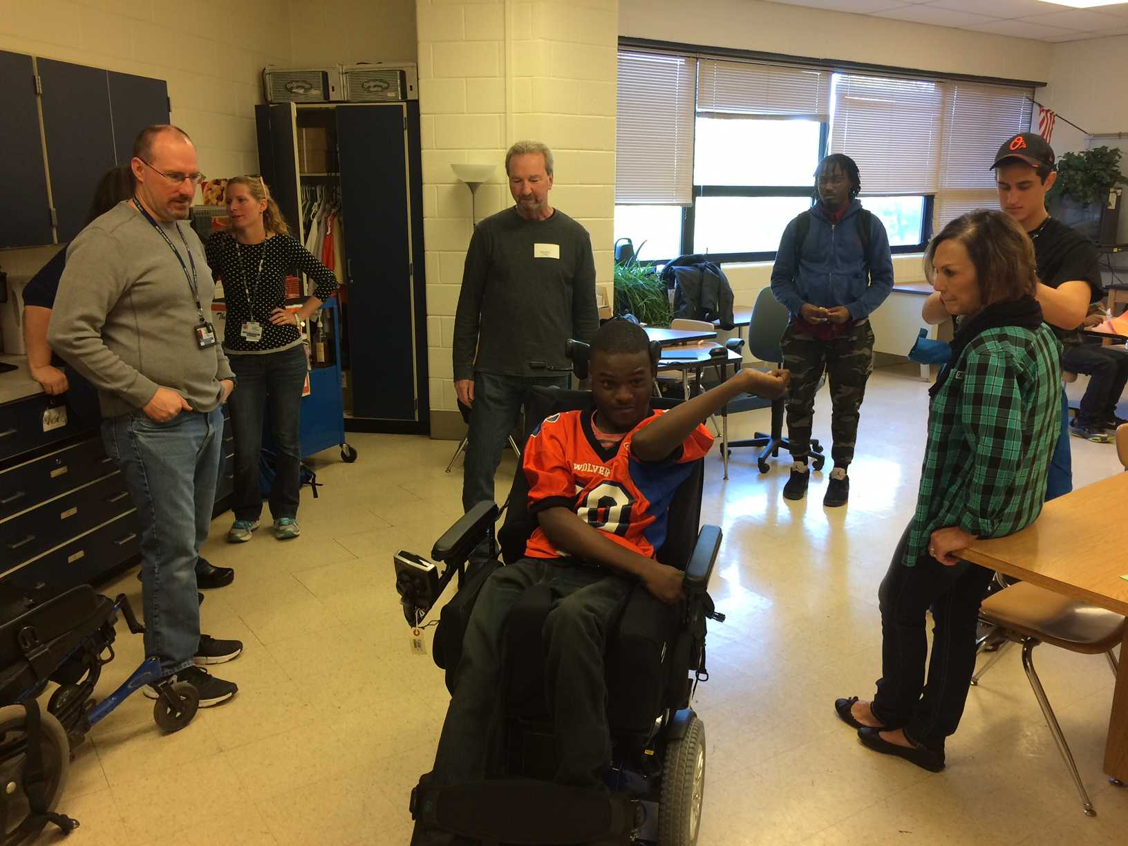 Senior Ibrahim Samia tries out his new wheelchair that he can control himself for the first time.