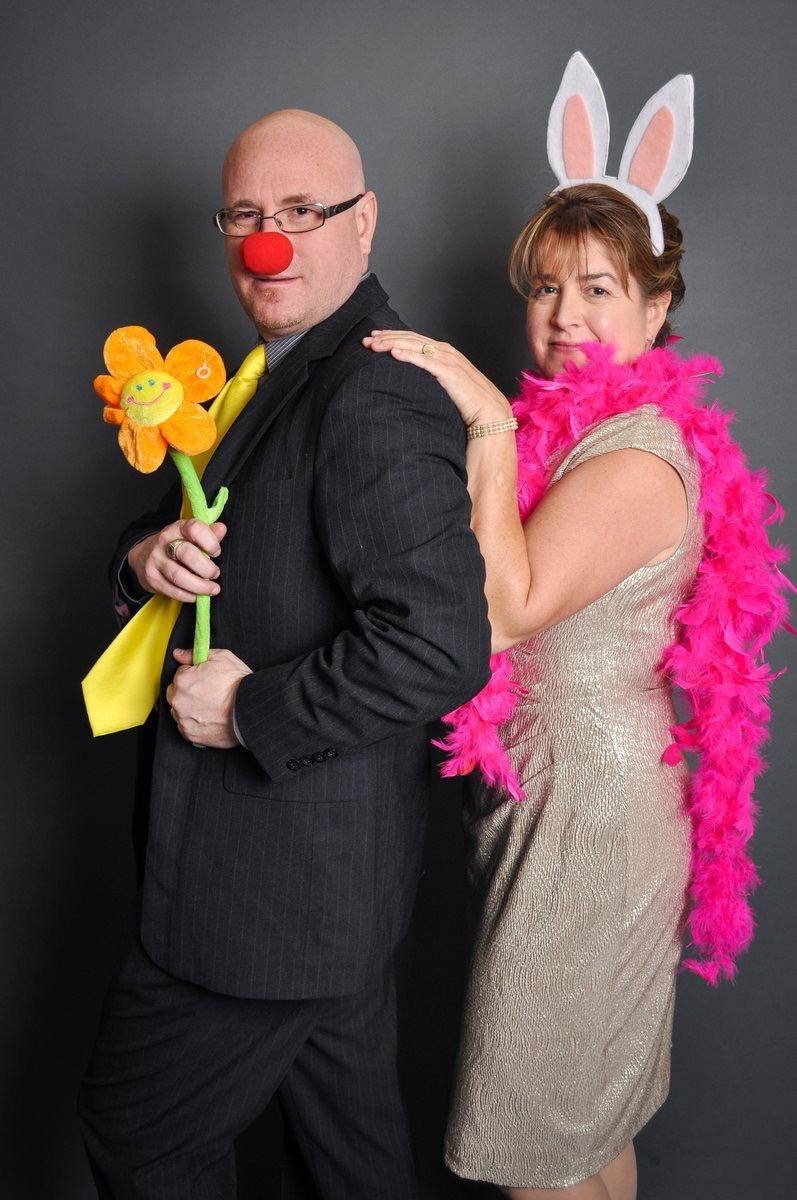 English teachers Scott Tarzwell and Ellen Stahly clown around in a photobooth at Stahly's son's wedding.