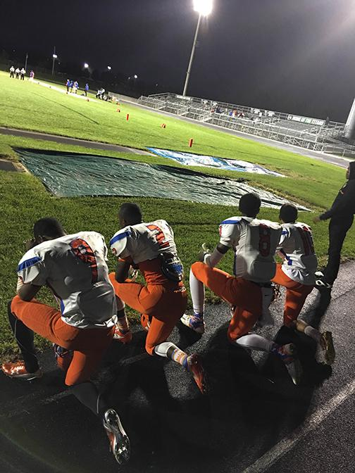 Members+of+the+Watkins+Mill+High+School+football+team+kneel+during+the+National+Anthem+in+the+game+against+Tuscarora+High+School.