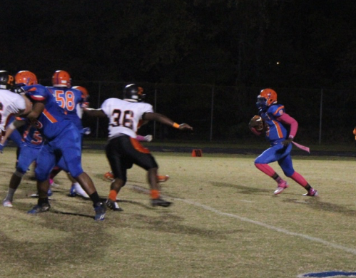 Quarterback Markel Grant runs the ball against the Rockville defense.