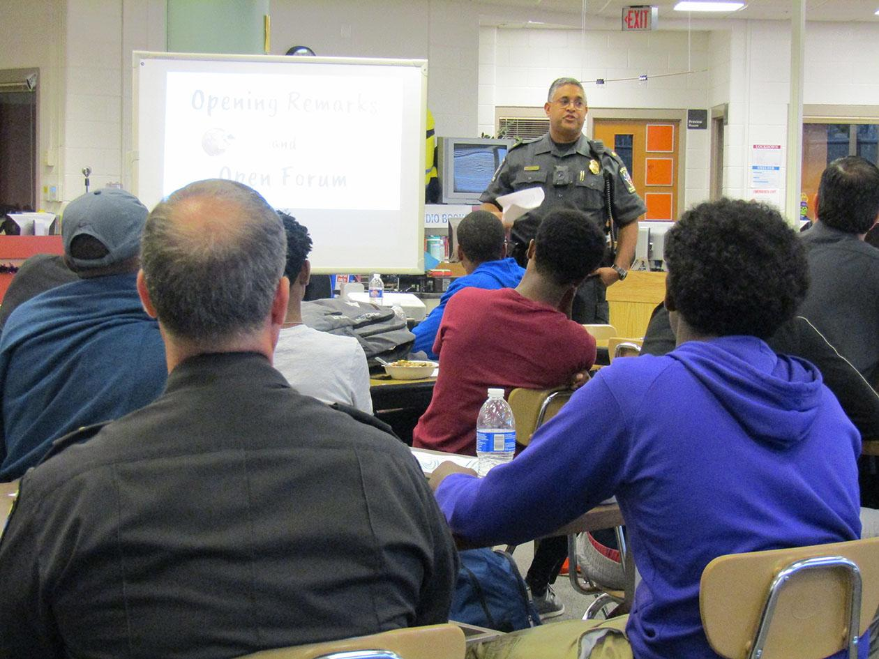 Students and teachers listen to MCPD Officer