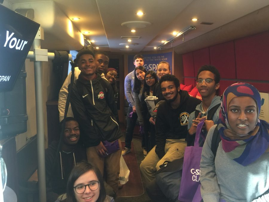 A+group+of+students+pose+for+a+photo+while+touring+the+C-SPAN+bus+at+Watkins+Mill