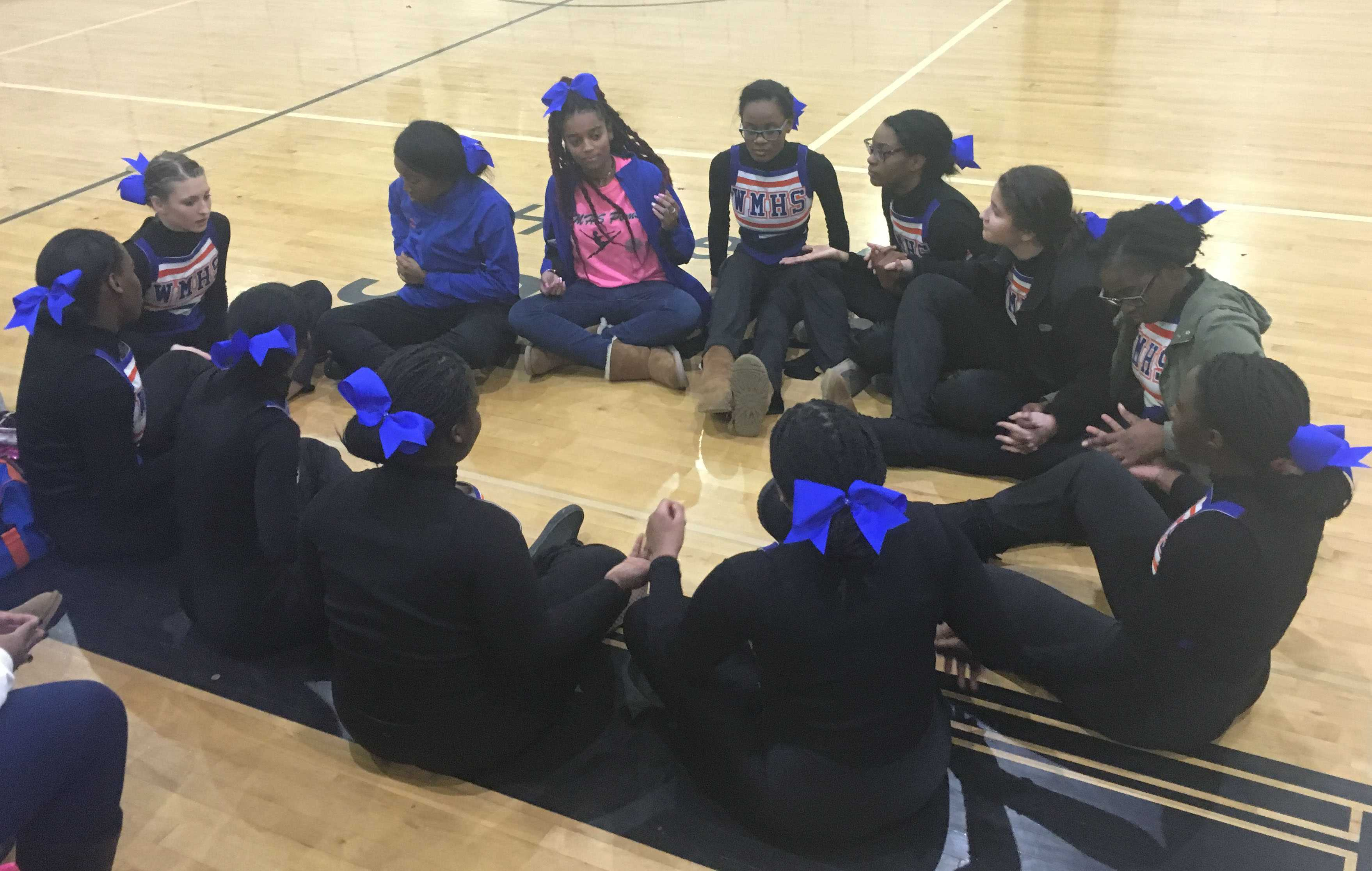 Watkins Mill Poms wait for results at Northwest Highs school