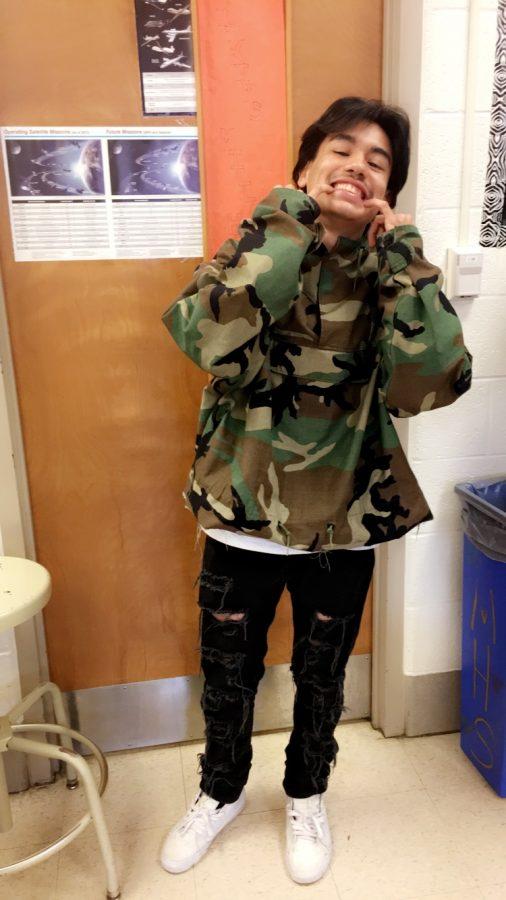 Junior Jelvani Fajardo poses in his fashionable outfit