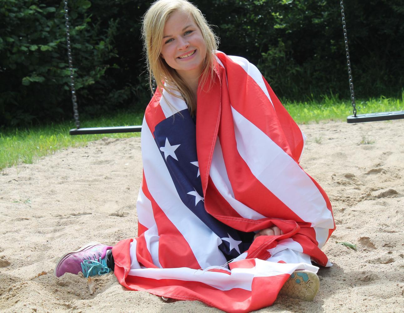 German exchange student Louisa Boockhoff posing with an American flag.