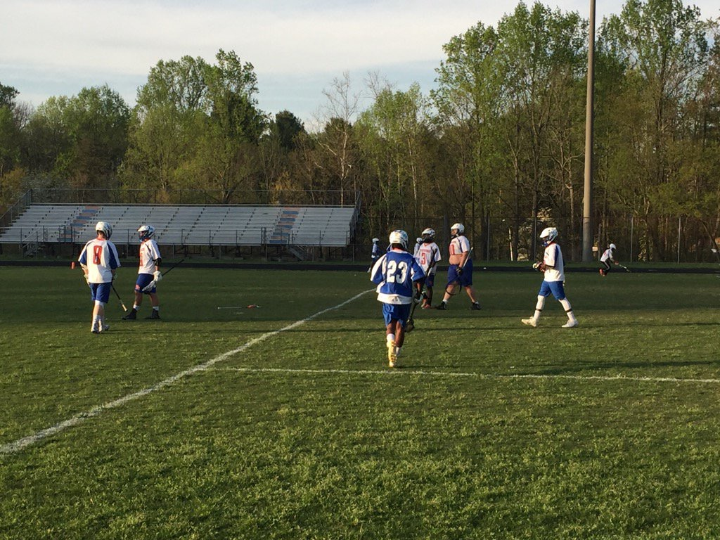 Boy+lacrosse+warming+up+before+their+game.