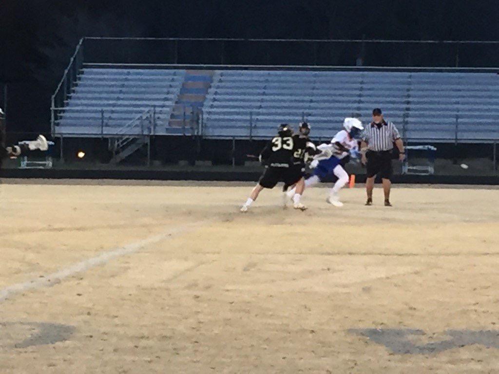 Boys tearing down the field.