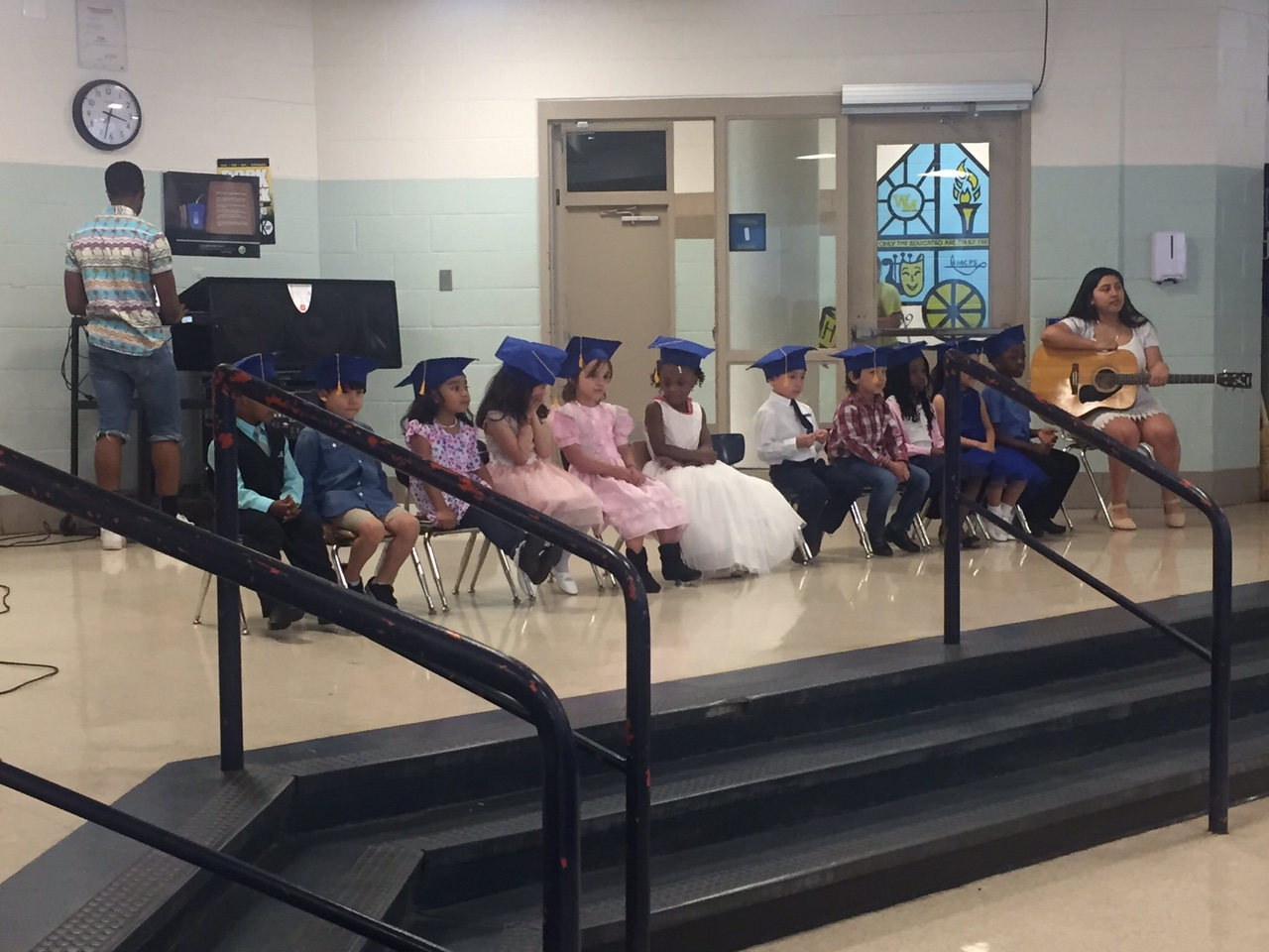 Preschoolers+wearing+their+graduation+caps+during+their+ceremony.+