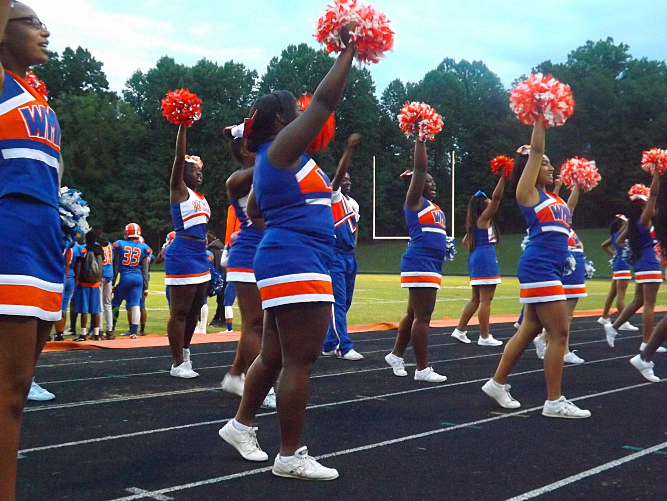 Cheerleaders on the sidelines at the football opener on September 1.