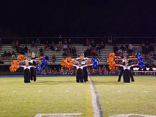 Poms performing at the football opener on September 1 at halftime.