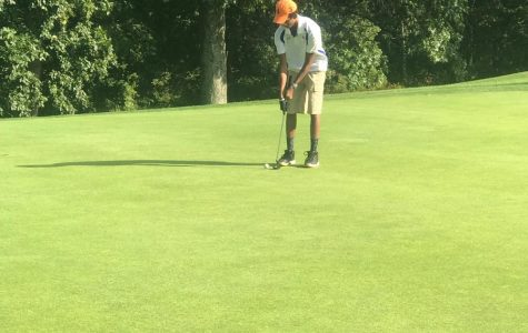 Senior Exlee Dawson lines up a putt