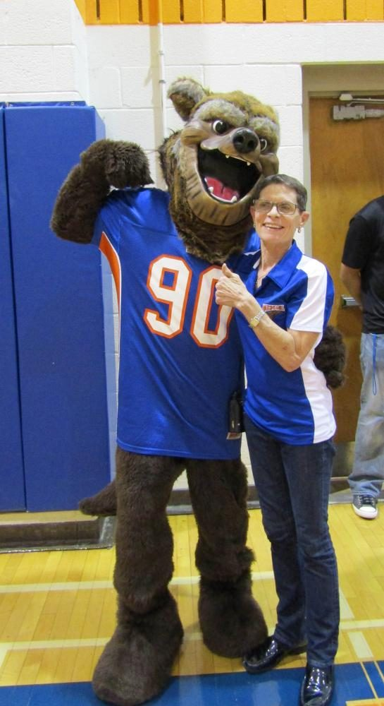 Principal Carol Goddard cheeses with the mascot.  Do you know his name?