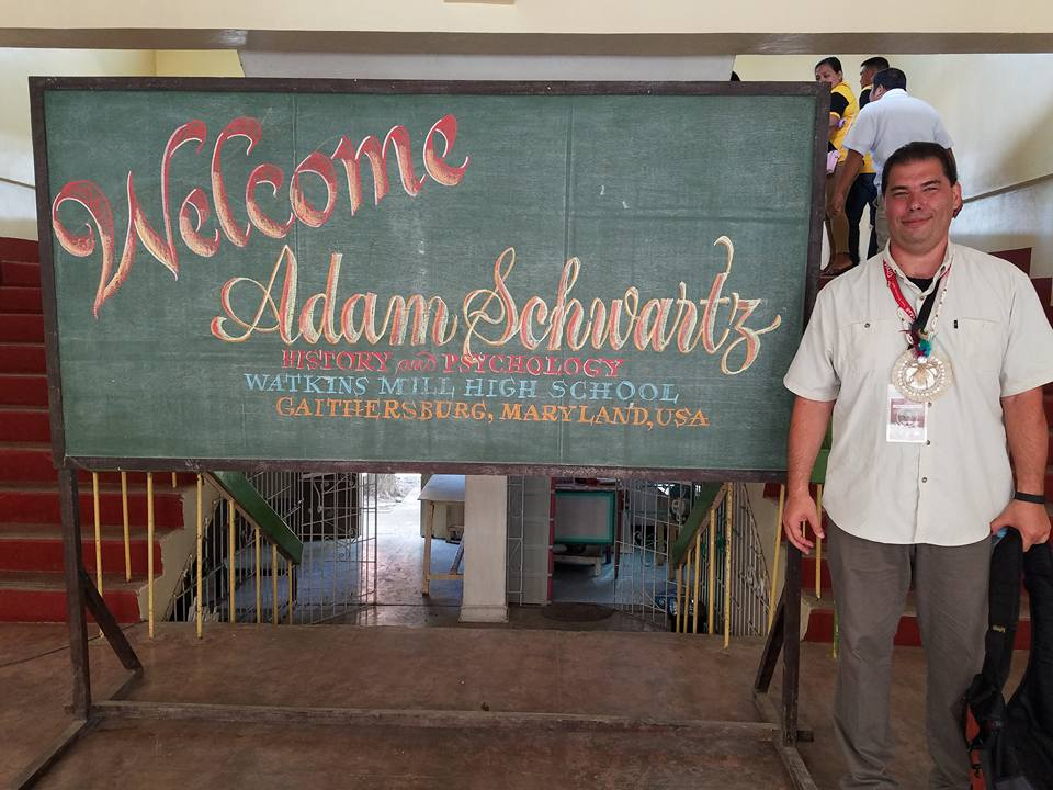 Social studies teacher Adam Schwarz is welcomed by his new students in the Philippines
