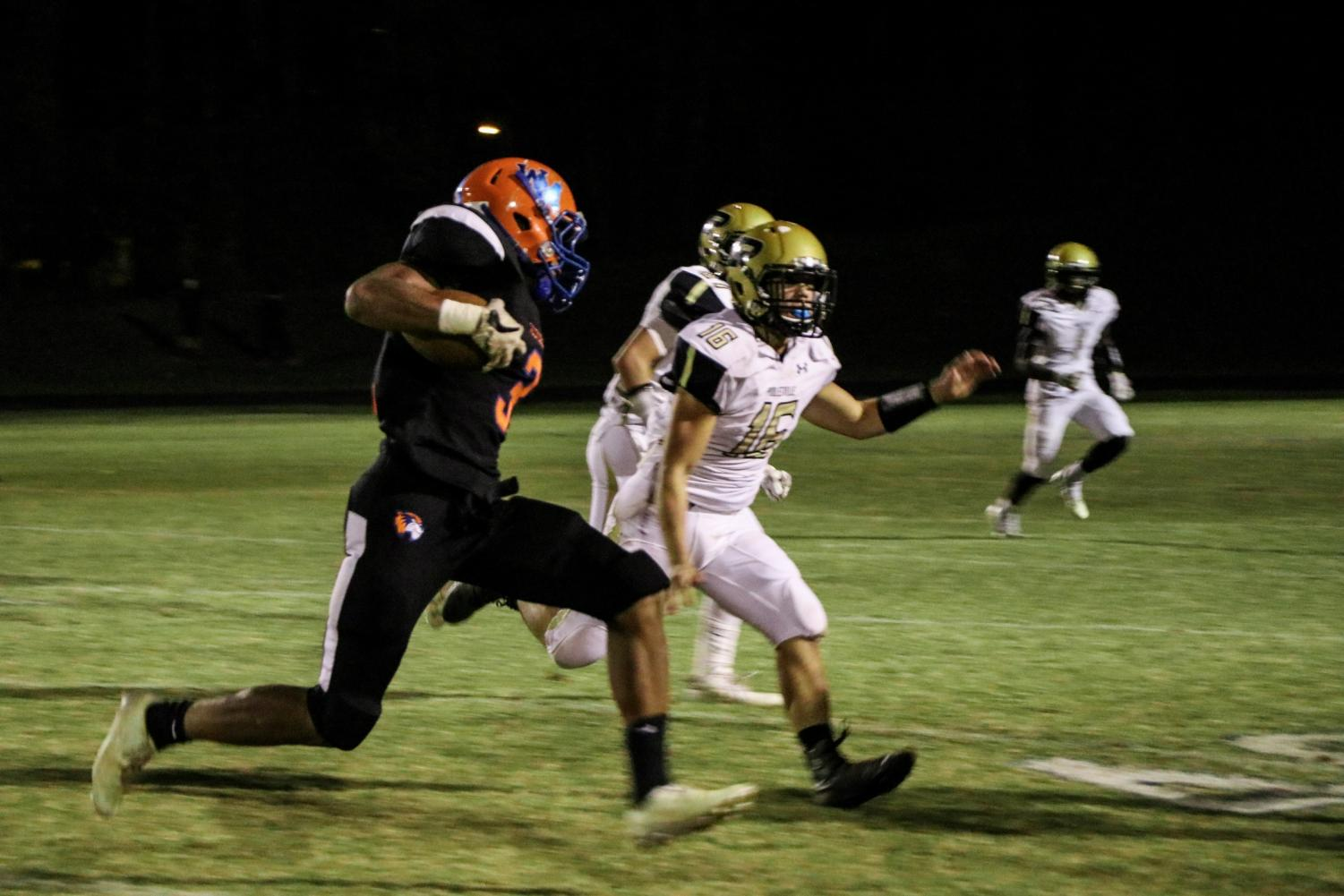 Junior running back Anthony Rush carries the ball on the outside