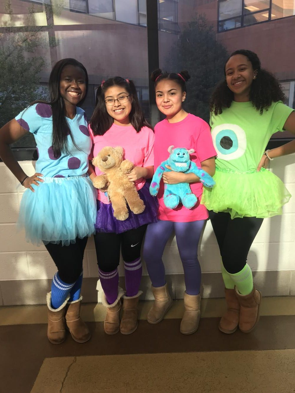 Sully (Eudel Ndong), Boo #1 (Dariana Girao Contreras), Boo #2 (Vikki Batres Jandres), Mike (Christina Cordero) dress as the cast of Monsters, Inc for tv and movie character day