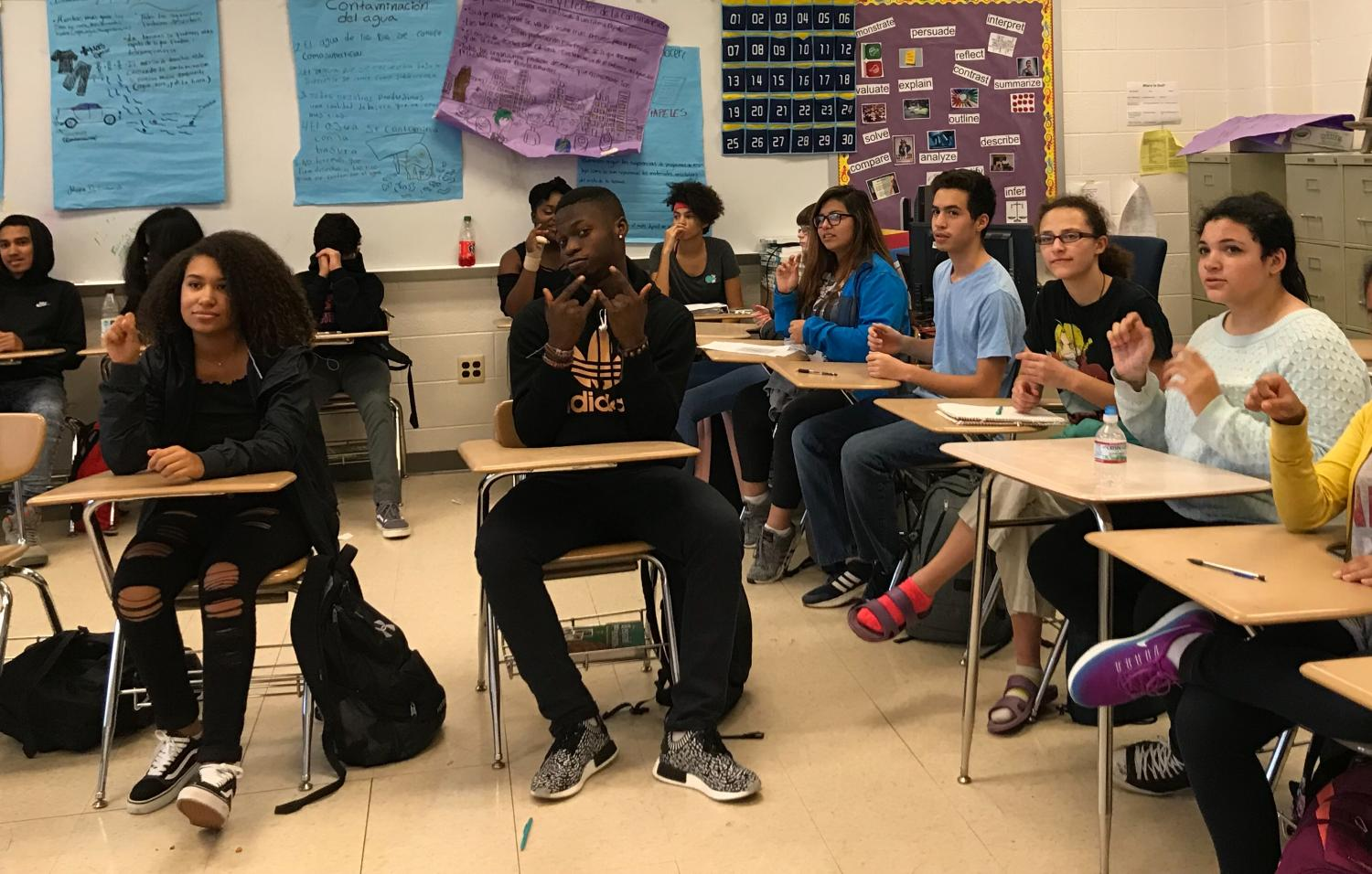 Students in the American Sign Language class practice their new skills.