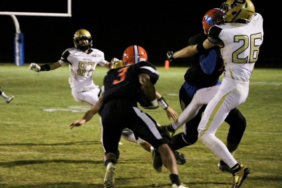 Junior running back  Anthony Rush looks for a hole to run through