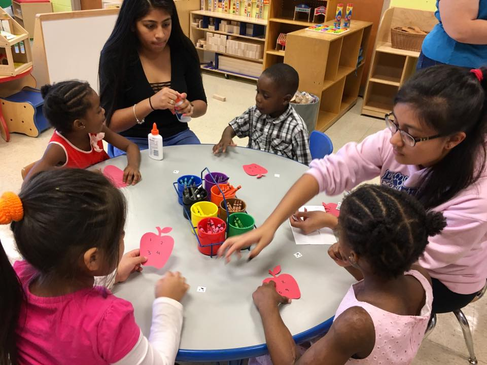 Students teach preschoolers using centers