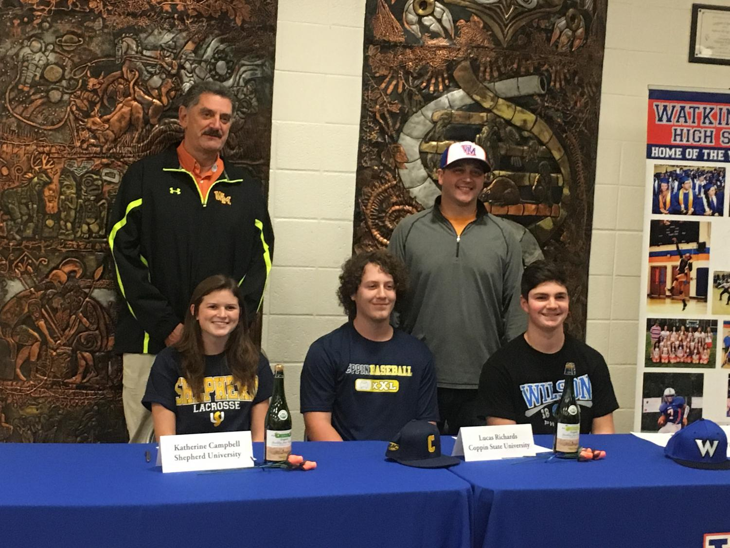 Katherine Campbell(Left), Lucas Richards(middle), and Kevin Finn(Right) with their coaches after signing letter of intent