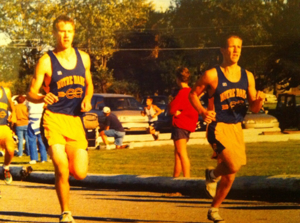 Engineering teacher Ed Graf (left) running track when he was in high school