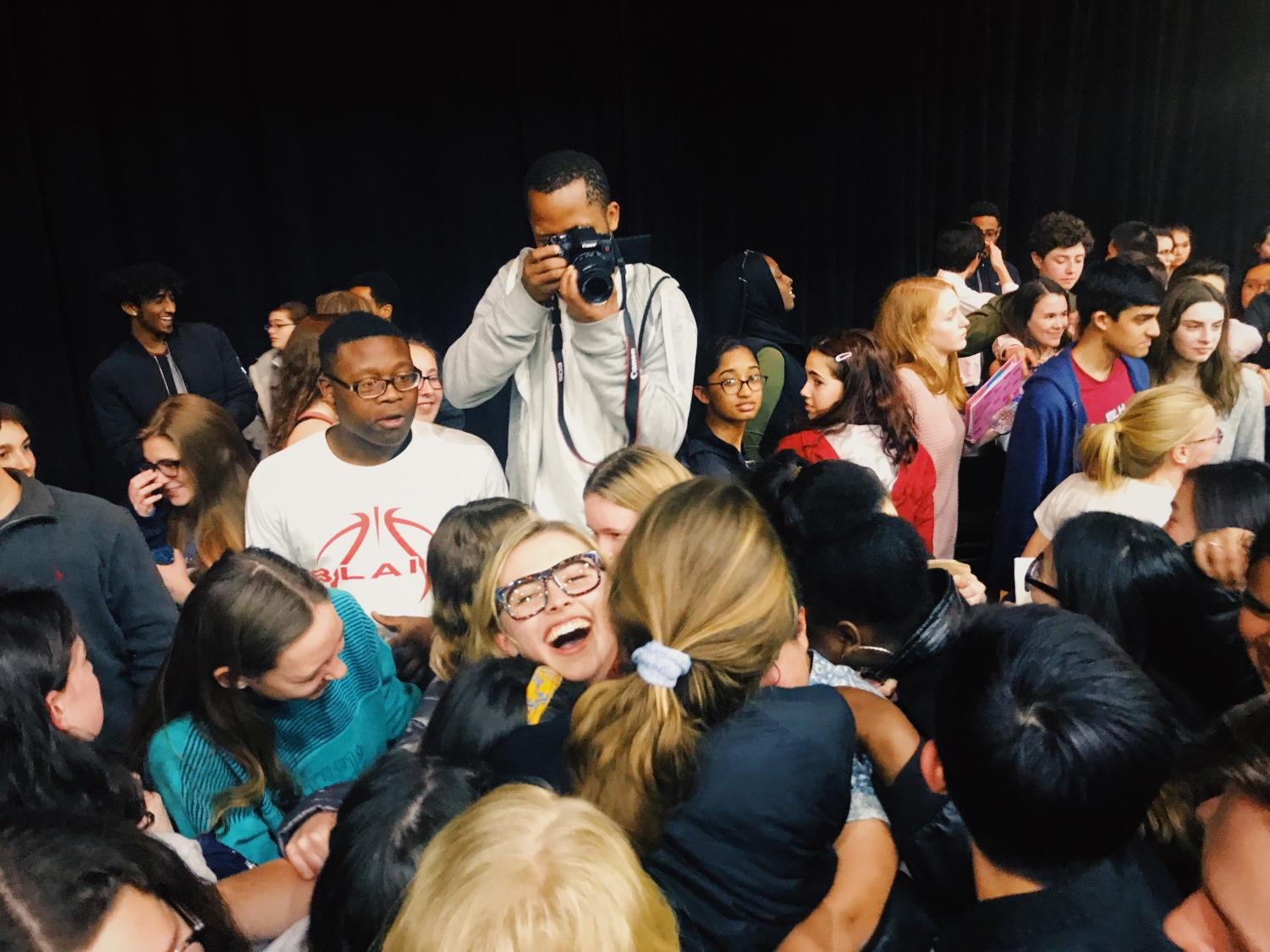 Marjory Stoneman Douglas High School survivor Delaney Tarr gives MCPS students a group hug after the event