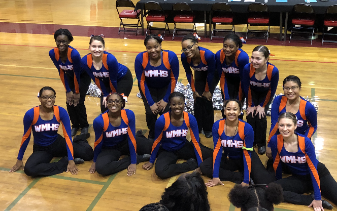 Poms getting ready to perform at counties