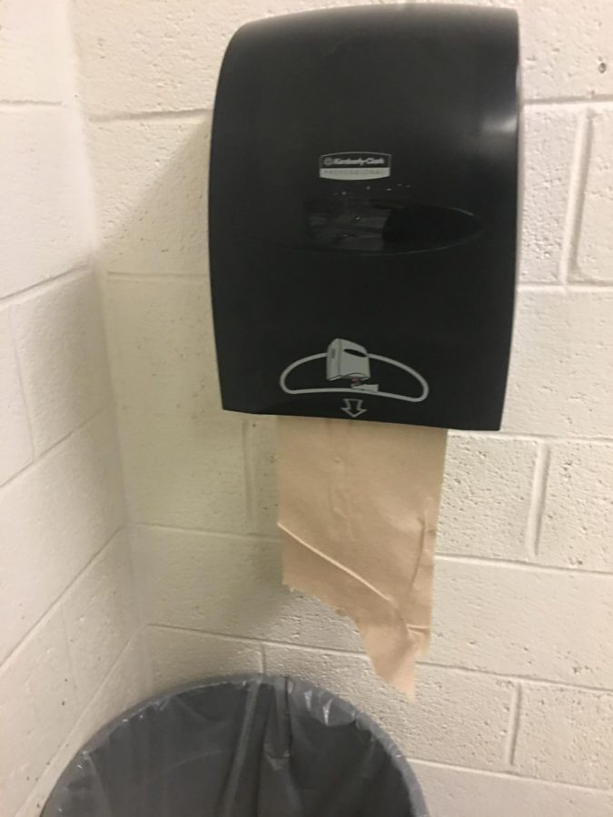 Motion-sensor+paper+towel+dispensers+were+recently+installed+in+bathrooms+to+help+reduce+paper+waste.