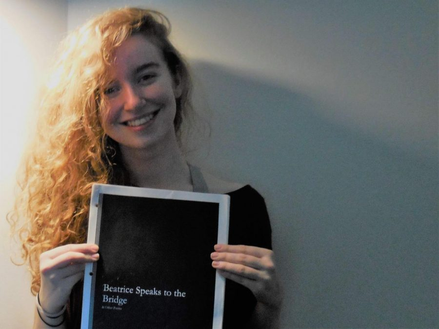 Watkins+Mill+alumni+Kathryn+Bratt-Pfotenhauer+with+her+poetry+book