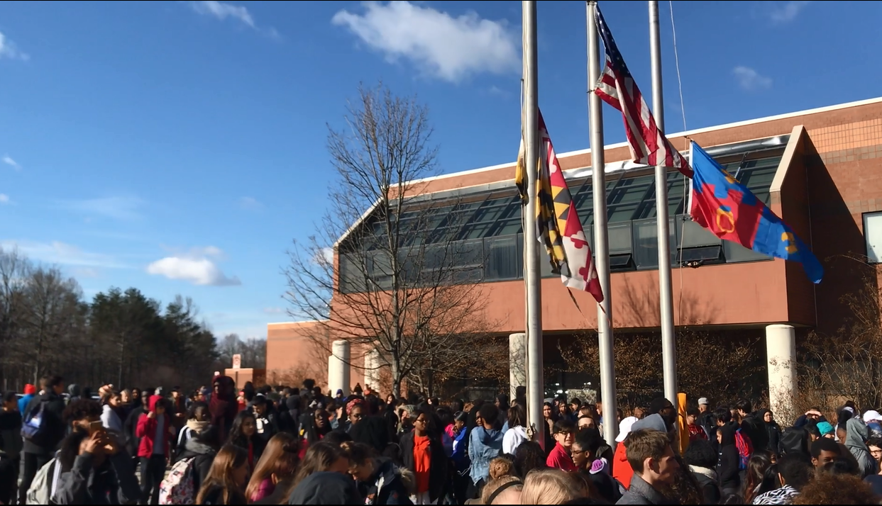 Students gathering at the flag poles for the school walkout.