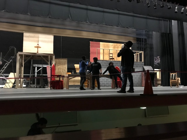 Director Jamaly Allen giving actors notes on stage.