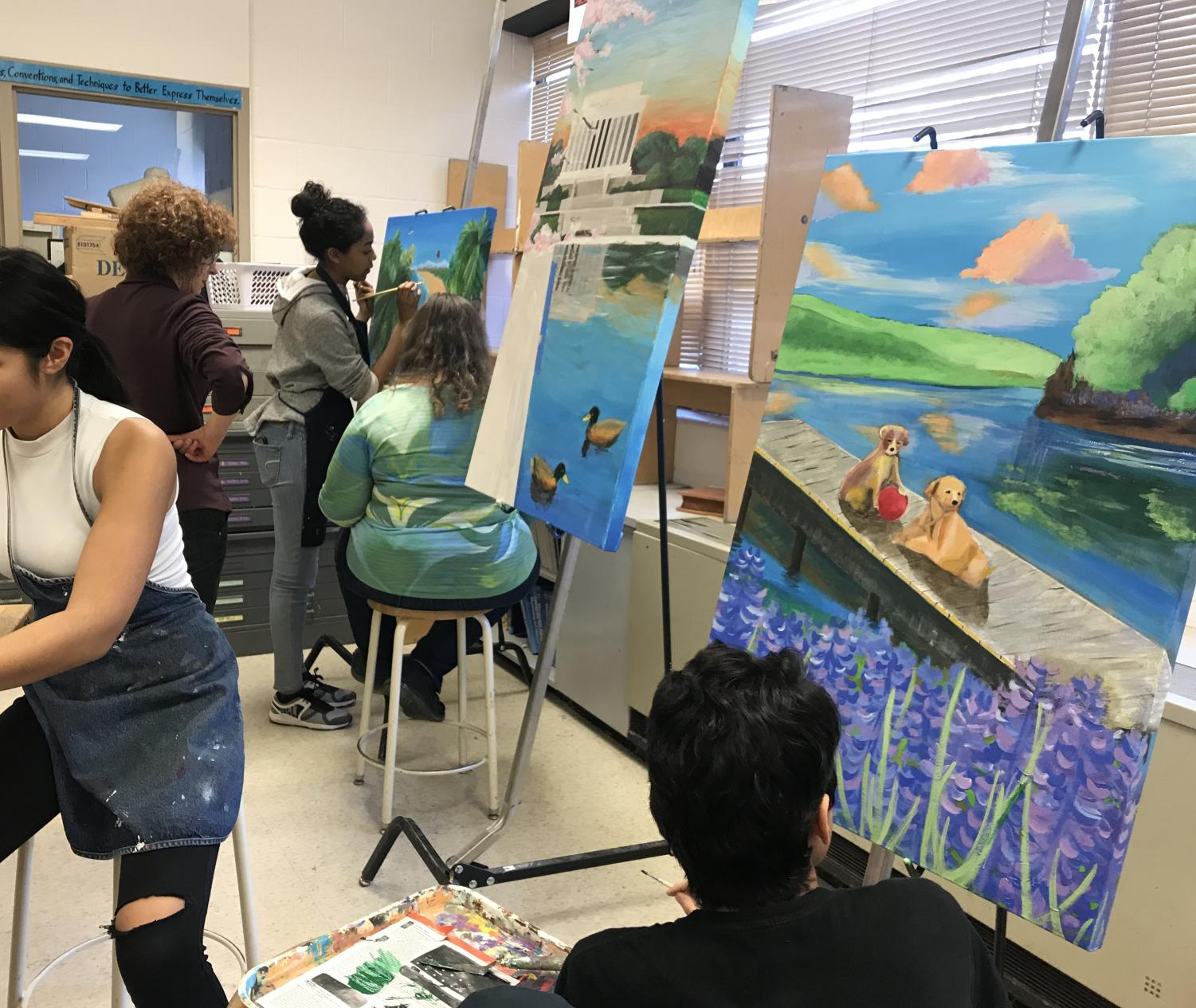 Students work on their artwork for the Youth Art for Healing program