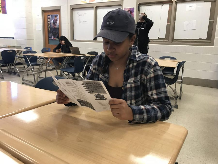 Senior+Christina+Cordero+reads+through+the+suicide+prevention+brochure+in+her+math+class