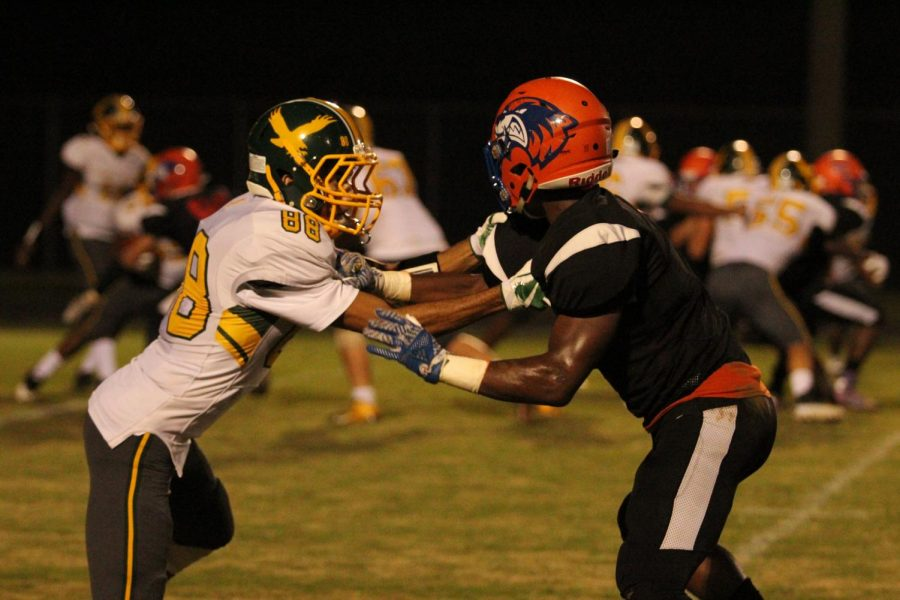 Demetrius Rush battles with a Seneca Valley player on the field