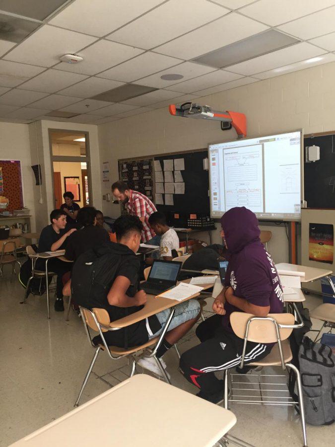 Freshmen in English teacher Chris Smith's class work on an assignment