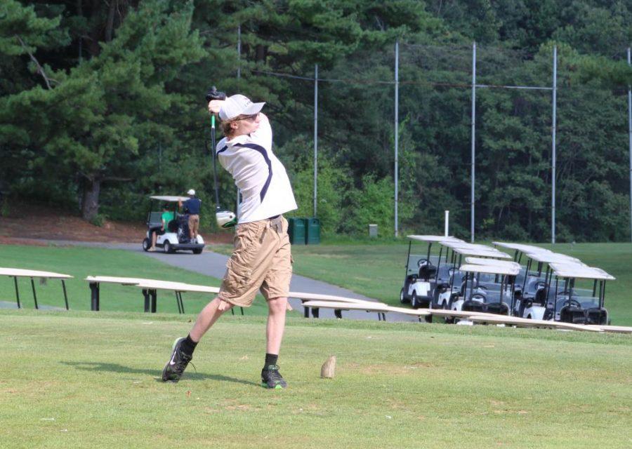 Freshman+Josh+Miller+swings+during+the+September+6+golf+match.